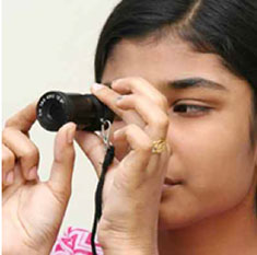 Girl using monocular telescope 1