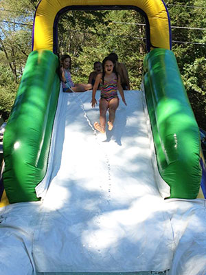 Girl sliding down water slide