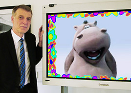 Photograph of Ian Bean with an interactive plasma screen