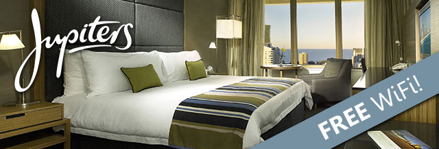 Image of a bed in a room and Jupiters Hotel with a banner across it saying 'FREE Wifi!'
