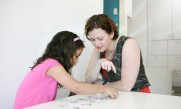 Working with a student on literacy and language activities - at 4 Little Monkeys clinic